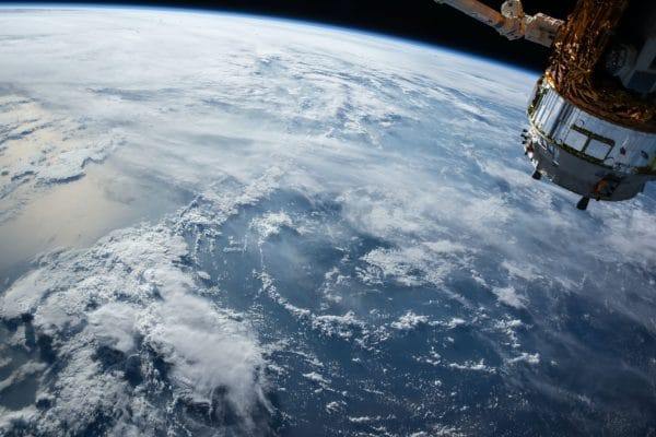 view of Earth and satellite