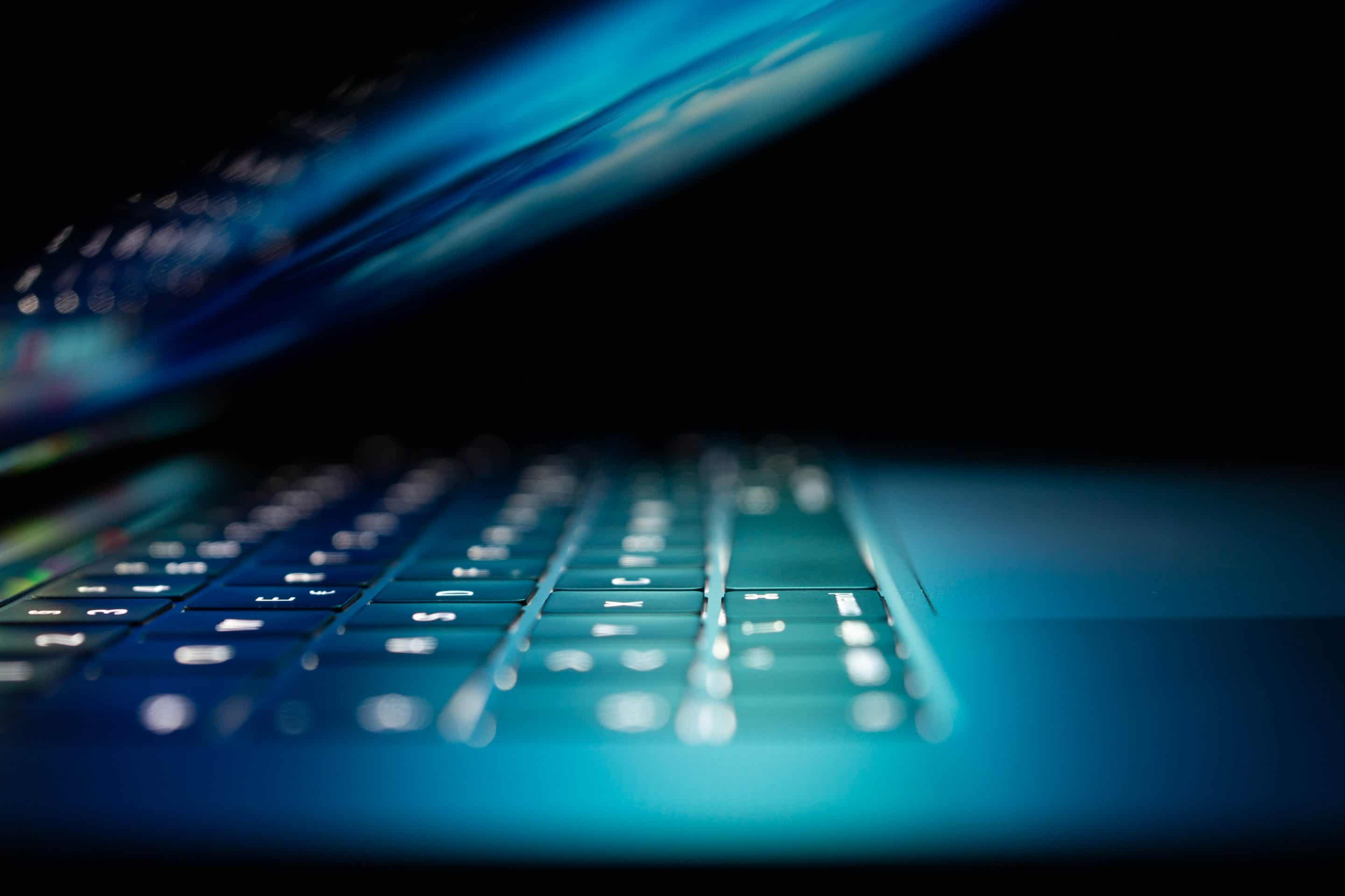 closeup photo of turned-on blue and white laptop computer